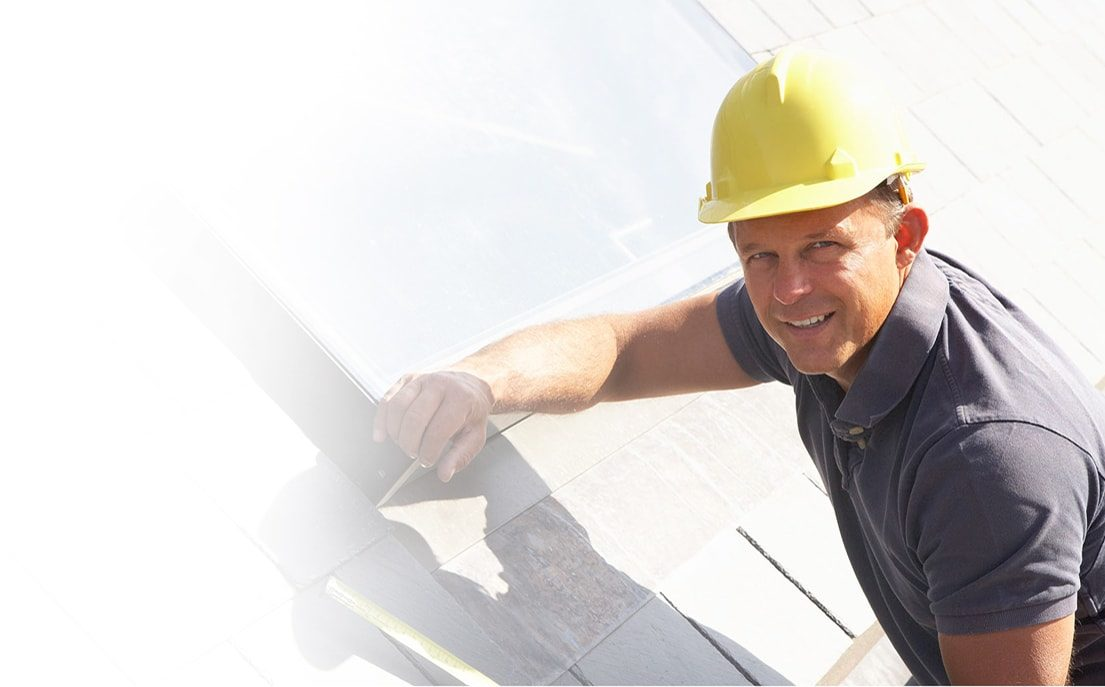 Man working on roof and smiling