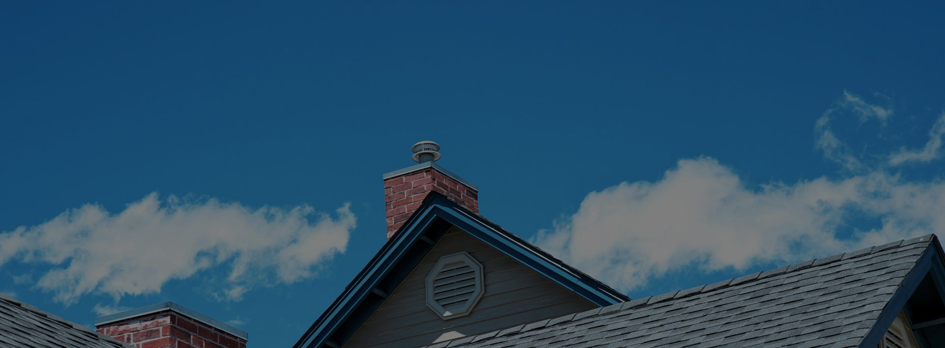 Top of a house with a chimney