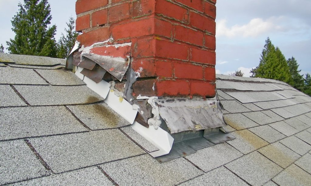 One of the warning signs that it's time for roof replacement is flashing damage.