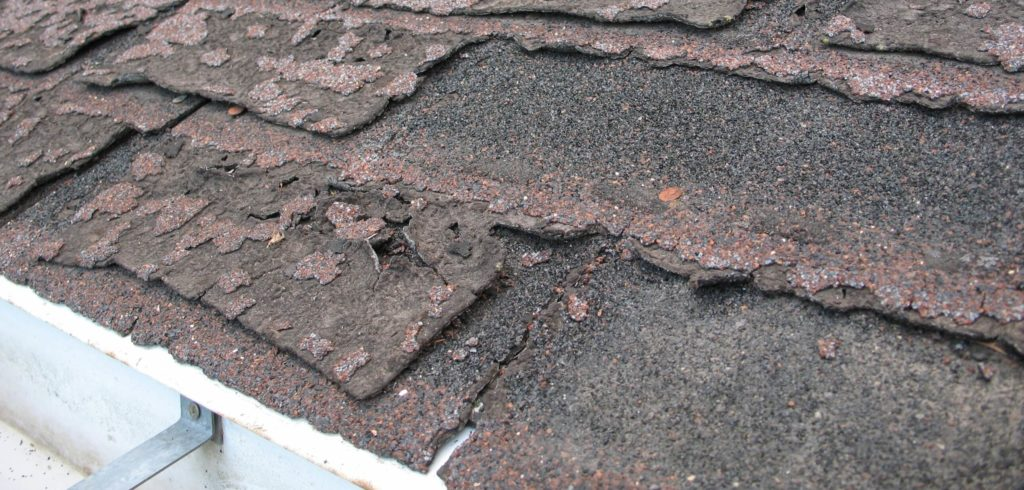 Roof shingle damage is a warning sign that it's time to replace your roof.